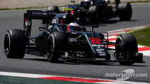 Jenson Button, McLaren MP4-31 on track ahead of Fernando Alonso, McLaren MP4-31