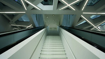 An escalator leads into the exhibition