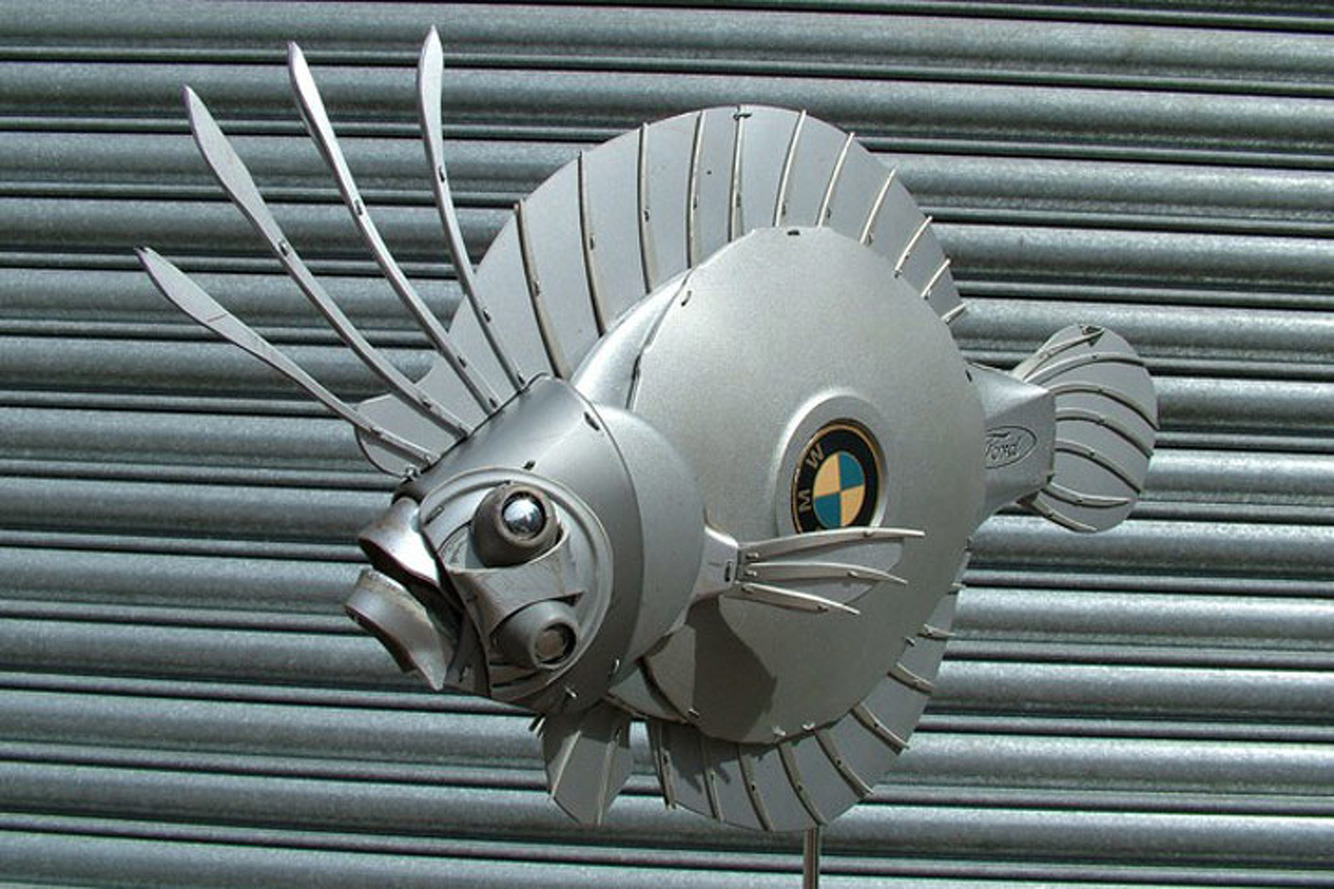 Artist Turns Hubcaps into Amazing Animal Sculptures