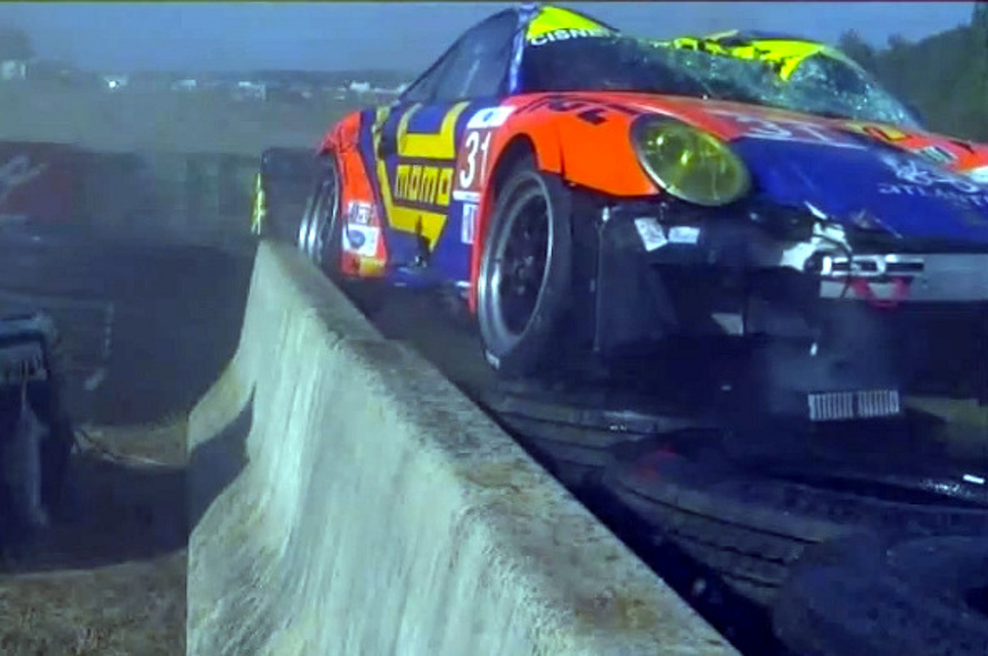 Porsche 911 Racecar Goes Airborne, Lands on Wall Inches from Cameraman [video]