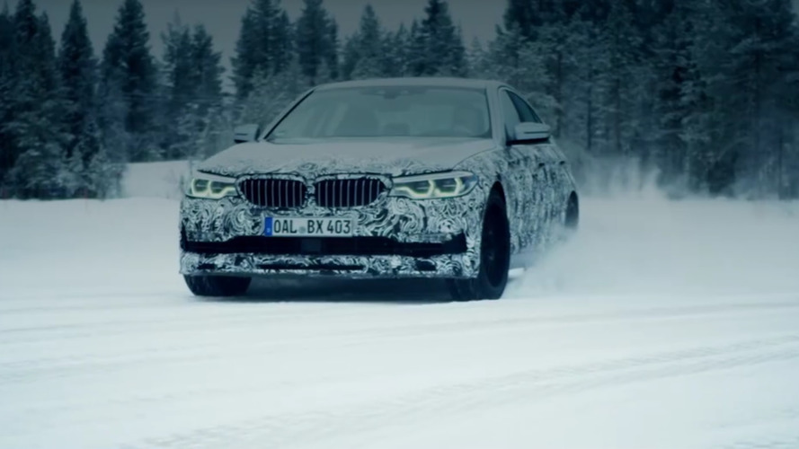 2018 Alpina B5 plays in the snow on its way to Geneva