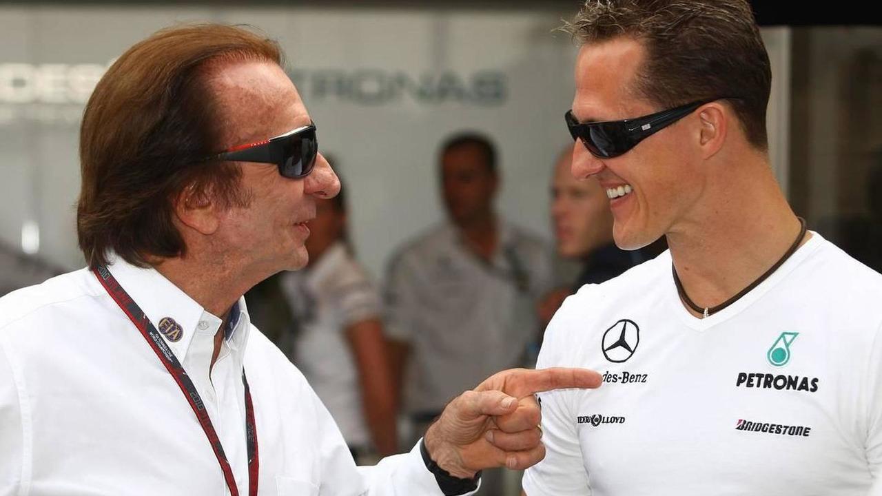 Emerson Fittipaldi (BRA) FIA Race Steward with Michael Schumacher (GER), Mercedes GP Petronas - Formula 1 World Championship, Rd 8, Canadian Grand Prix, 13.06.2010 Montreal, Canada